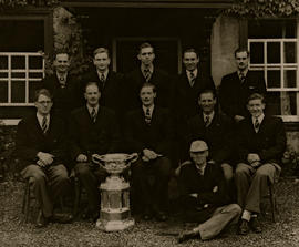 TRC crew in the Grand Challenge Cup 1948 posing with trophy