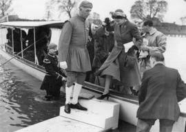 Princess Elizabeth disembarking from Enchantress, assisted by a Doggett's Coat and Badge winner