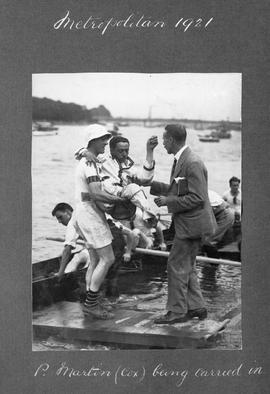 Metropolitan 1921 - P Martin (cox) being carried in