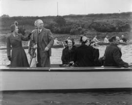 Princess Elizabeth and others on board Enchantress, watching crews marshalling for the Head of the River Race