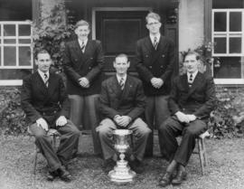 TRC crew in the Stewards' Challenge Cup 1948 posing with trophy