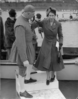 Princess Elizabeth disembarking from Enchantress, assisted by Doggett's Coat and Badge winner Bert Barry